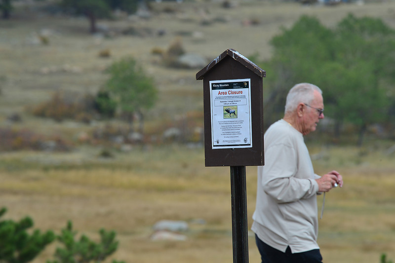 Walt Hester | Trail-Gazette<br /> A national park visitor walks into the Moraine Park meadow, oblivious to the closure sign. The national park has closed meadows in the park for the fall rut, as bulls can get dangerously aggressive, and elk get stressed from the extra attention.