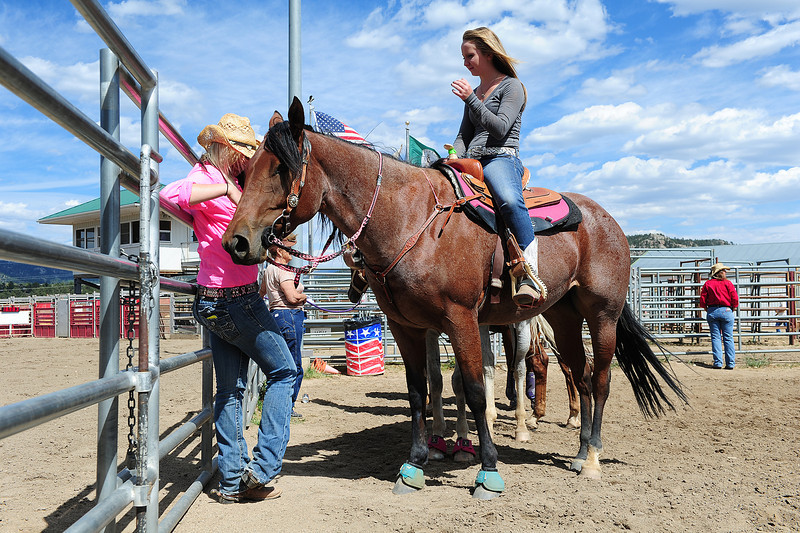 Walt Hester   Trail-Gazette<br /> Shelbi McMurtry, 17, of Brighton, left, and Raleigh Symonds, 14, of Erie await their opportunity to compete on Sunday's barrel racing at the Stanley Fairgrounds. The barrel races were the second such event of the season.