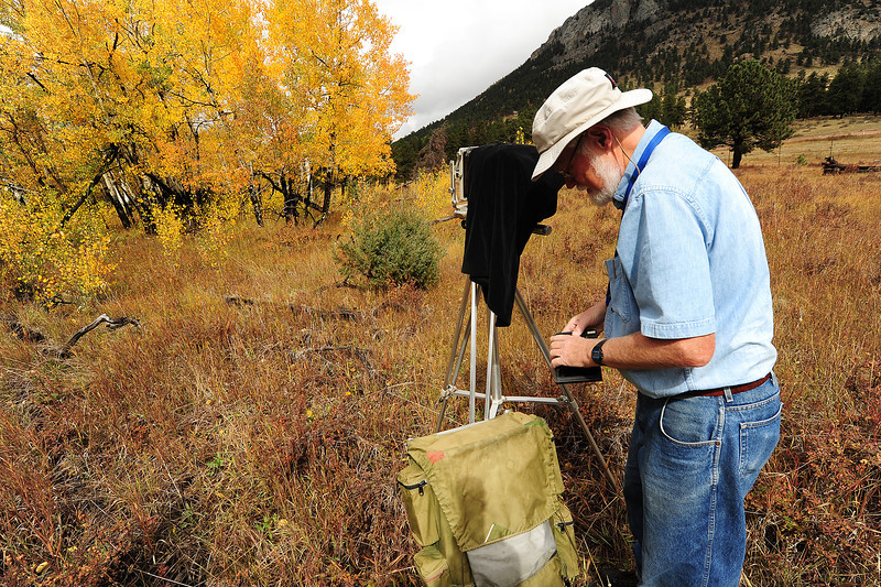 Walt Hester | Trail-Gazette<br /> Outdoor photographer John Ward changes film plates in his 4x5 view camera in Rockie Mountain National Park on Wednesday. The aspens are peaking around the park, attracting admirers.