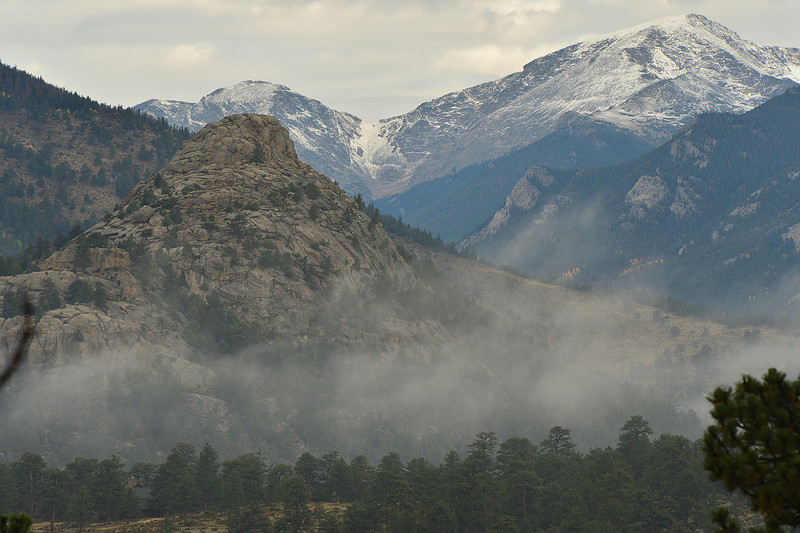 Walt Hester | Trail-Gazette<br /> Fog drifts past Old Man Mountain and clouds glide over the Mummy Range on Thursday. The unsettled weather signals the new season in the mountains around Estes Park.