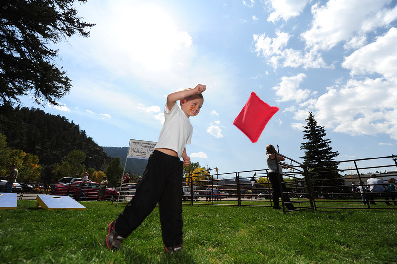 Walt Hester | Trail-Gazette<br /> LJ Oliver, 3, of Thornton sports a tiger face and tosses a bean bag in Bond Park on Saturday. The Autumn Gold offered diversions for children as well grown-ups.