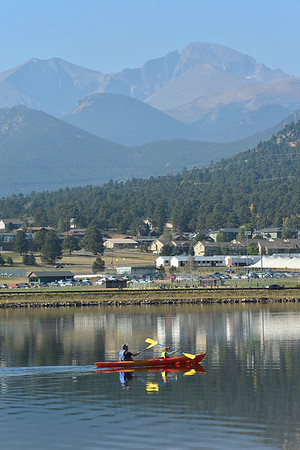 Walt Hester | Trail-Gazette<br /> A father and child glide across Lake Estes on Saturday. The weekend offered planty of chances to enjoy the outside.