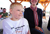 Walt Hester | Trail-Gazette<br /> Nicholas Van Landschoot, 6, rests after Saturday's race and his fund-raising. The young runner raised $205 for Partners Mentoring Youth, the most of any individual for the Running of the Bulls.