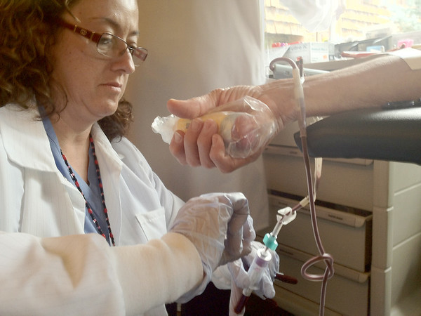 Lorraine Valencia of Poudre Valley Heath Systems adjusts a bag at the fall blood drive at Estes Park Medical Center on Monday. The blood drives happen three times each year in Estes Park.