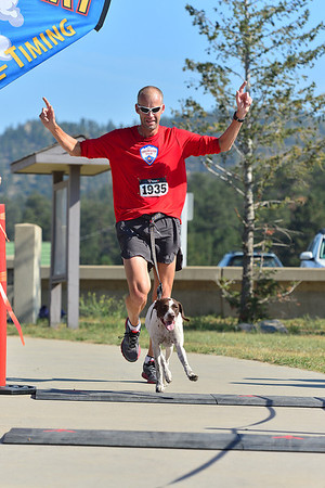 Walt Hester | Trail-Gazette<br /> Steve Wens and running partner, Athena, cross the line at the annual Running of the Bulls on Saturday. The pair won the dog-running catagory.