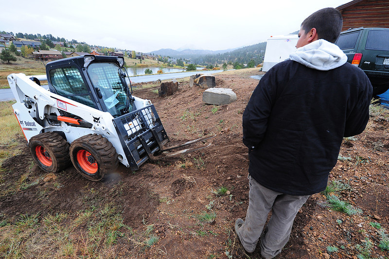 Walt Hester | Trail-Gazette<br /> Landscapers move rocks around on soggy ground on Wednesday. Small businesses create the most jobs in the US economy.