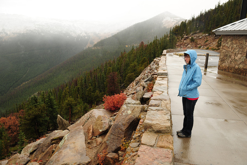 Walt Hester | Trail-Gazette<br /> Snow and clowds don't dampen the spirits of Summer Boggess of New York City at Rainbow Curve. The chilly, wet weather temporarily closed the nation's highest throughway.
