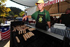 Walt Hester | Trail-Gazette<br /> David White turns brats on Saturday at the annual Autumn Gold festival in Bond Park. The two-day event offers visitors food and fun and, this year, plenty of sunshine.