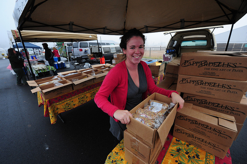 Walt Hester | Trail-Gazette<br /> Jewel Campbell of Lakewood unpacks her gourmet pasta one last time for the season at the Estes Valley Farmers' Market on Thursday. The market returns next year on the first Thursday in June.
