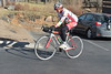 A rider from the Jelly Belly pro cycling team heads out of Estes Park on Sunday. Outdoor activities were a challenge over the weekend do to wind and smoke.