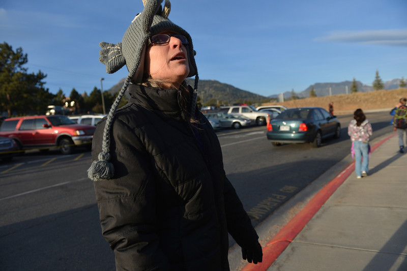 Elementary school principal Karen Glassman dons her elephant winter hat to keep warm while greeting students on Tuesday morning. The school principal could see much cooler temperatures as she meets kids next week.