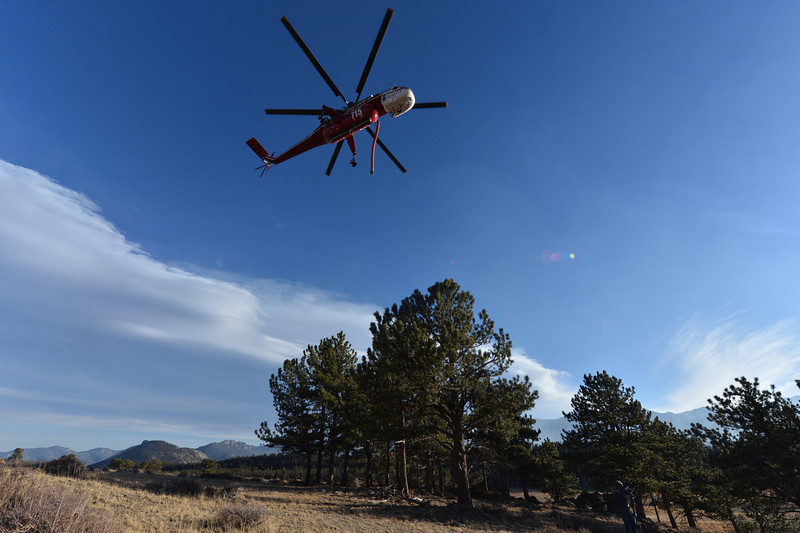 A huge sky crane helicopter swoops into Upper Beaver Meadows to refill on Monday. The big type-1 helicopter was brought in to fight the Fern Lake Fire.