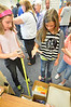 Jen Johnson drops an egg three feet into one of several padded boxes at the Estes Park Elementary School's science fair on Thursday. The fair is a chance to show off what students have learned and to apply the knowledge in a fun way.