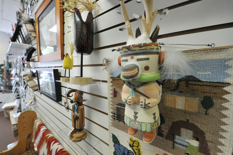 A deer kachina created by Hopi artist Poly Estewa hangs in Canyonlanfs Indian Arts gallery. The gallery features Native American jewelry, pottery, fetishes and, of course, kachina dolls.
