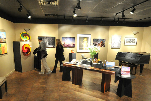 David and Cathy Dunning of Lincoln, Nebr., admire the work at the Cultural Arts Council gallery on Sunday. The weekend included the Jazz Fest, but also included the Art Walk, a self-guided tour of local galleries.