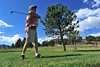 Joel Brown of Estes Park lobs his shot toward the green on the Lake Estes Nine-Hole Course on Monday. Mornings will be the best time to get rounds in, as clouds, rain and lightning are appearing in the afternoons.