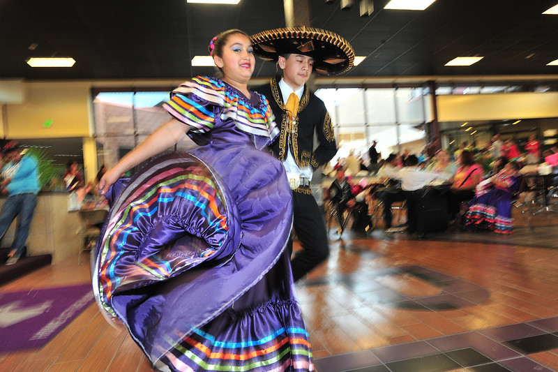 Dancers tap, swirrel and float across the floor during the Dia de los Ninos celebration at the Estes Park High School on Saturday. The event not only promotes multi-cultural understanding, but fun, art and literature, as well.