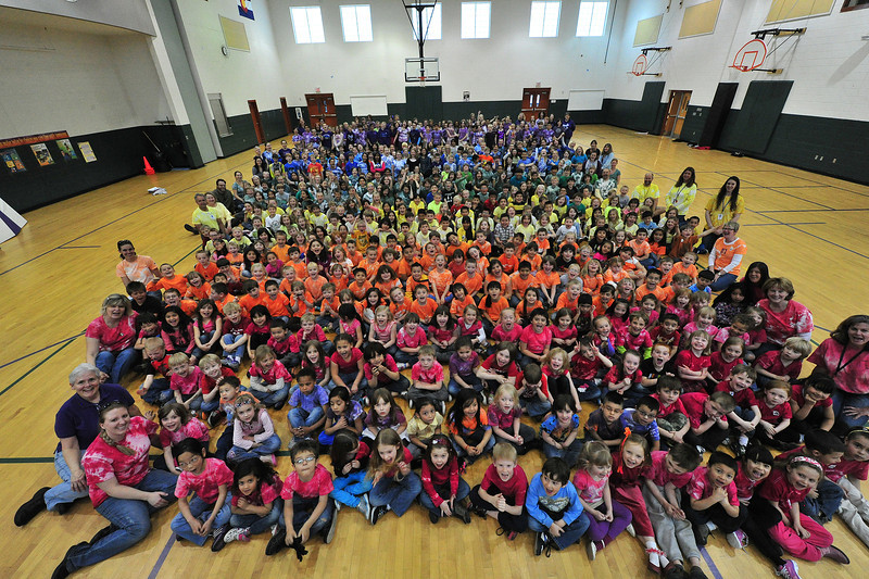 The entire Estes Park Elementary Schools poses for their annual picture in the gym at the school on Friday. Rainbow Day is the event that the student wait all year to enjoy with the shirts they dyed in September.