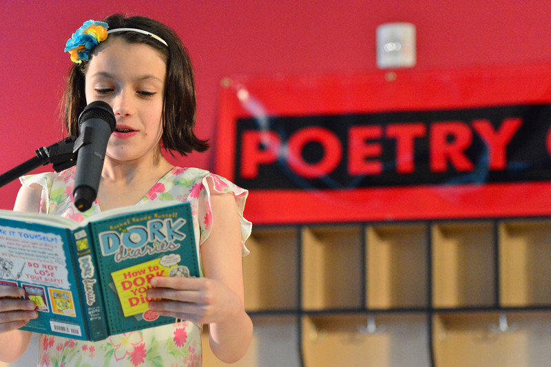 Gabby Fisher reads to classmates, friends and parents at the annual Poetry Cafe on Thursday. The annual event exposes younger readers to poetry as April, National Poetry Month, draws to a close.