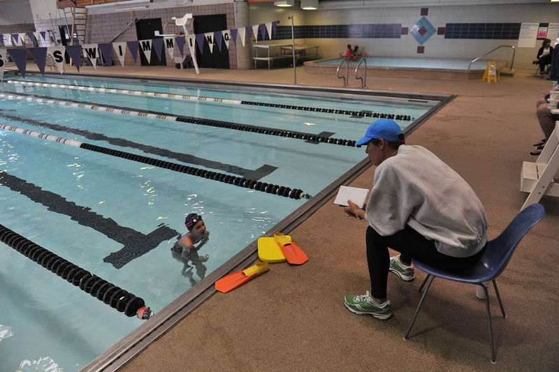 04EPSEar Mom Helps.jpg Ann Sievers and daughter Cathrine, 8, of Columbia, Mo., nearly have the aquatic Center to themselves on Monday. Ann, a former collegiate swimmer, was coaching Catherine through her own workout.