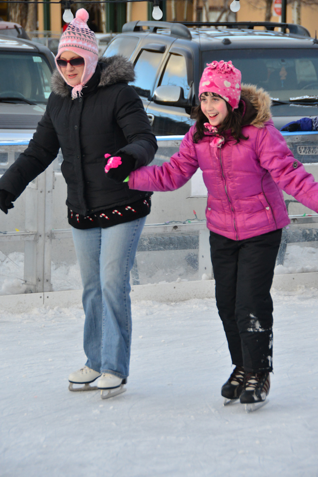 02ep ice rink 2.jpg A helping hand assists a young skater taking a turn around the downtown ice rink located at the intersection of Elkhorn and Riverside Drive in Estes Park.