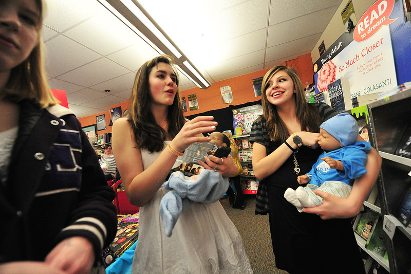 Josephine Christiansen and Isabella Ulibarri cart baby dolls around on Thursday. The girls are in Parenthood and Child Development Training, a class at Estes Park High School, gives students a small taste of what it is like to care for a child every minute of every day.