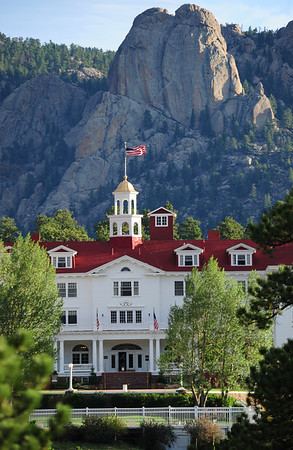 03EIO Cover Landmarks.jpeg Walt Hester | Trail Gazette<br /> Morning sunshine hits the Twin Owls and the Stanley Hotel sideways on Wednesday. Seasons change the way light dances off of the Estes Park landmarks.