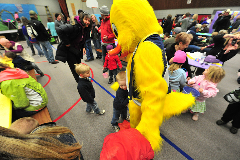 Quilten T. Canvas, another minion of spring, takes hugs at the Easter Bunny's big event on Saturday.