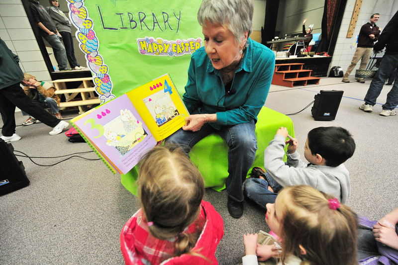 Kerry Aiken of the Estes Valley Public Library reads a bunny story to children at the Breakfast with the Easter Bunny on Saturday. While the egg hust was still outside, many more activities were inside, out of the chilly wind.