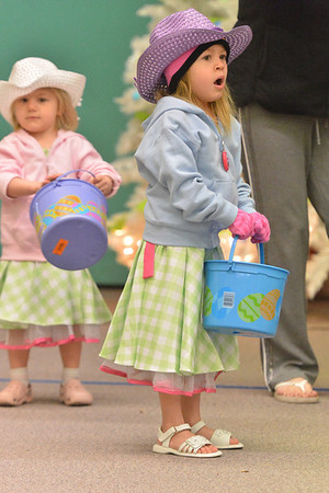 Kylie Jo, 5, and little sister, Addy Quattlebaum, 3, of Denver, prepare for the egg hunt at the old elementary school on Saturday. The event was open to everyone, local or visitor, young or old.