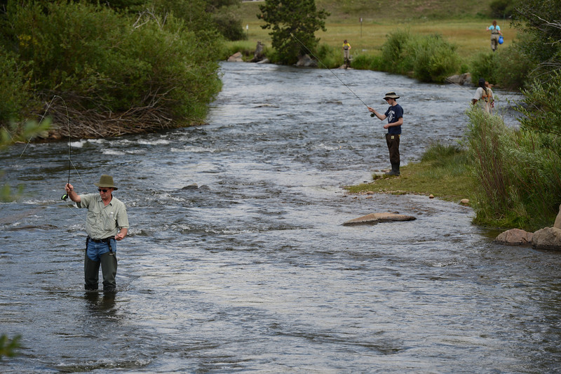 20ep sear.jpg Walt Hester | Trail-Gazette<br /> Fisherman flock to the Big Thompson River below the Olympus Dam Spillway on Wednesday. The Big Thompson is one of the most popular spots to flyfish in the area, year-round.