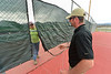 Di Campolong and CR Athey, Parks and Trails maintenance manager for the EVRPD, remove nets from between tennis courts on Wednesday. The nets were placed on the fences for winter's wind and snow.