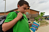 Travis Houser, 8, of Estes Park carries a growing project home from school on Wednesday. With summer fast approaching, many of the elementary school creations and projects are heading home, along with the memories associated with them.