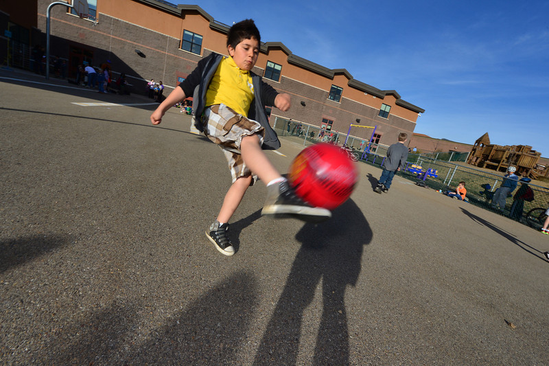 Miguel Gonzalez, 9, gets a kick out of the wlak-ride to school day on Tuesday. When students arrived at the elementary school, activities and breakfast were waiting.