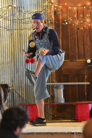 """Peter Irish, half the team of the """"Boundless Adventures of Peter and Ambree"""" juggles six balls, three by hand and three by feet, at the Elkhorn Lodge on Saturday. The performance was part of the lodge's Old Time Carnival, put on by the local Boy Scouts and Explorers"""