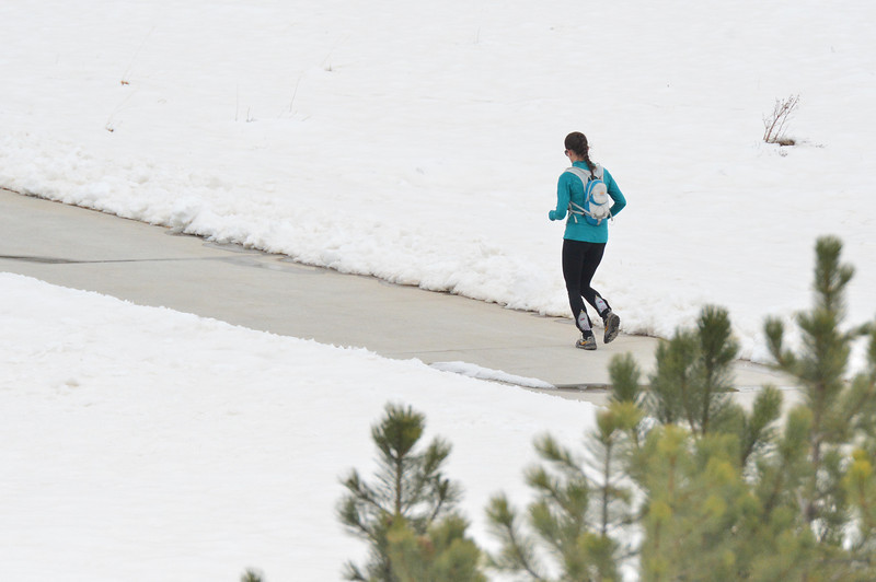 A dedicted running trains through the cold on Saturday morning. Dedication will be tested agains as snow piles up in Estes Park.