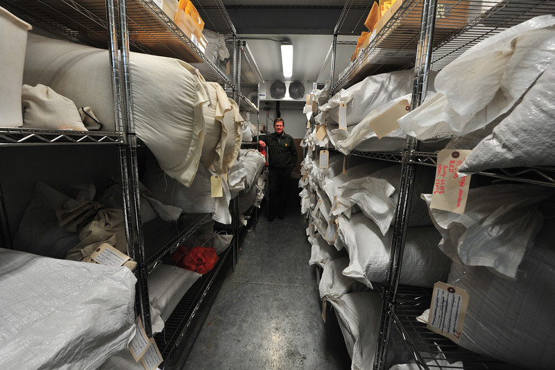 Jim Cheatham stands in the Rocky Mountain National Park's seed storage unit and it's three to four thousand pounds of seeds on Saturday. The seeds will be used to revegetate the 22 acres of disturbed area along Bear Lake Road, as well as other spots throughout the national park.