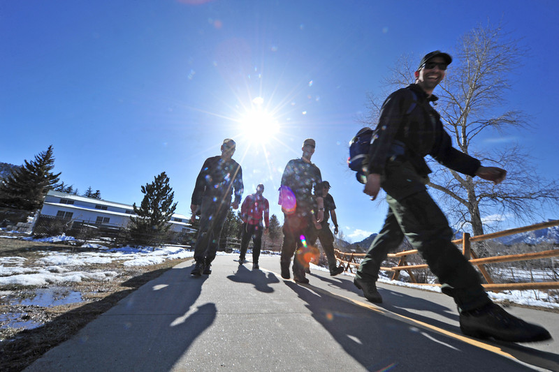 Rangers and firefighters from Rocky Mountain National Park trudge along the Lake Estes Trail on Wednesday. The group was performing the arduous pack test, a 45-minute hike with 45 pounds over three miles.