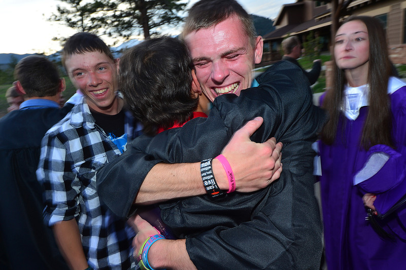 Jon Youngbluth gets emotional as he hugs classmate and fellow graduat Sean McAlpin at ceremonies on Friday. Thre class of 2013 was small and close-knit; many had spent all of their school years together.