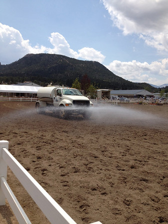 A water truck wets down the arena during the July 26-28 Hunter Jumper show being held at the Fairgrounds at Stanley Park.