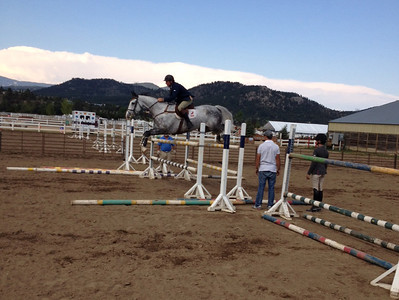 Horse and rider clear an obstacle at the July 26-28 Hunter Jumper show being held at the Fairgrounds at Stanley Park.