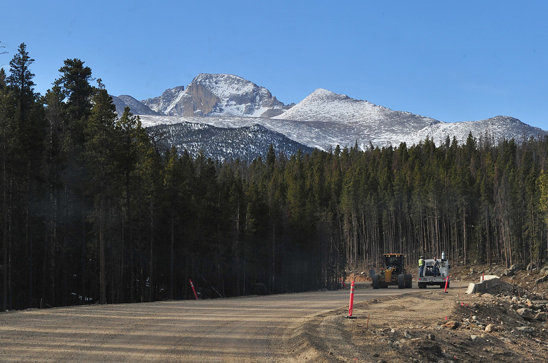 Work continues on Bear Lake Road on Monday under the looming east face of Longs Peak. Much of the new road is still unpaved as the visitor season draws near.