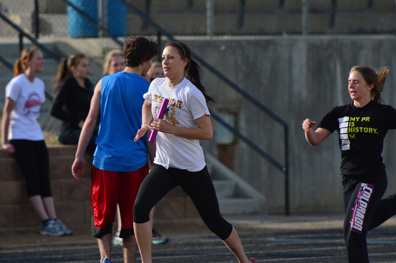 Erin Barkin takes the baton and runs during the high school track workout on Friday. The team is hoping for good weather as the season hits its stride.