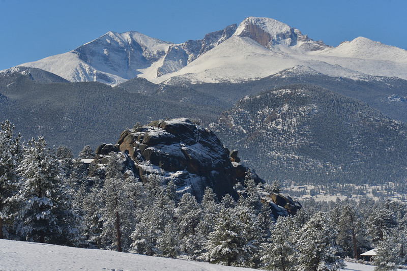 Longs Peak towers over the snow-covered valley on Wednesday. By the afternoon, most of the snow had melted off in the sunshine and 50-degree temperatures