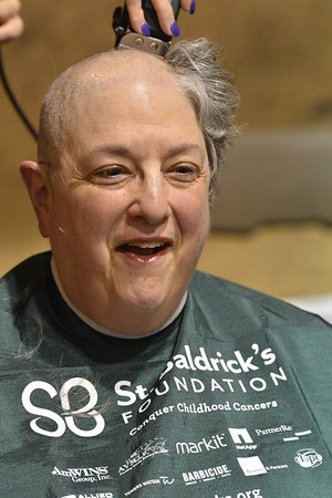 Barb Winter laughs as her hair goes. Winter raised $800, mostley from her younger brothers.