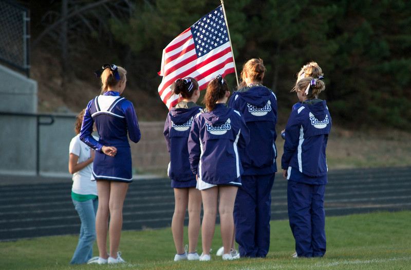 "Photo by Walt Hester<br /> Estes Park High School cheerleaders hold 'Old Glory"" for the National Anthum before Tuesday's soccer game."