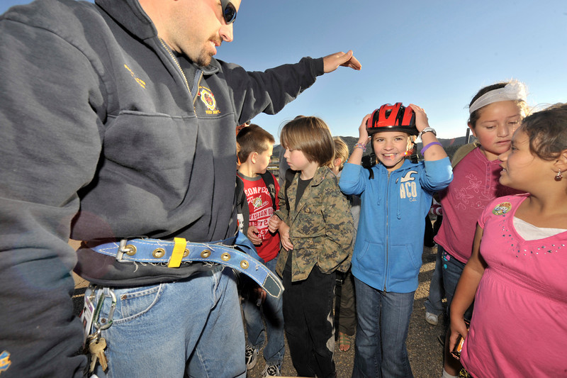 Photo by Walt Hester<br /> Estes Park Elementary School children gather around for a free bicycle helmet at the school on Wednesday morning. The event was part of the walk and ride to school day.