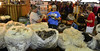 Sacks of wool sit on a table in Barn W in the Fairgrounds at Stanley Park Saturday during the June 8, 9 Estes Park Wool Market.