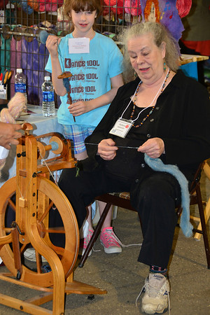 Stefania Isaacson spins fiber into yarn Saturday in Barn W at the annual Estes Park Wool Market held at the Fairgrounds at Stanley Park. Isaacson was a workshop instructor.