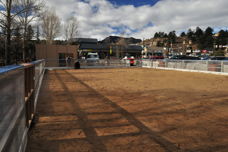 22EPNews Start as Sand.jpg Sand covers the floor on Wednesday of what will soon be the town's Holiday ice skating rink. The mobile rink is an impressive undertaking, with pipe, boards, sand and coolent.